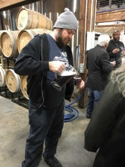 Jake Grove pours beer at the first Brewery Tour with
