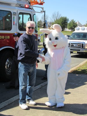 Easter Bunny Patricia Marciano and Rotary Club of Hillsborough President Anthony Franchini.