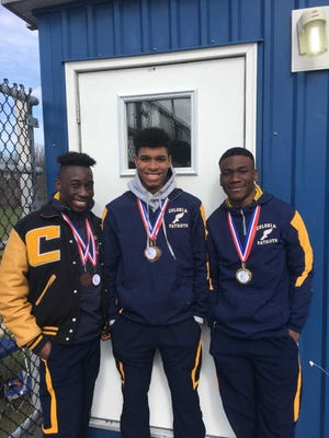 Colonia High School track athletes Edem Acolatse, Dylan Hendricks and Ayomide Oyewole pose during the Metuchen Relays on April 7, 2018.