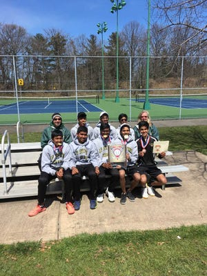 The J.P. Stevens boys tennis team poses after winning the 2018 GMCT title.
