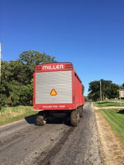 The Wisconsin Department of Transportation recommends drivers should slow down immediately whenever they see a slow-moving vehicle emblem (orange and red triangle) on the rear of a tractor or other piece of equipment.