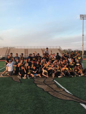 The South Brunswick boys track team is all smiles after winning the GMC Relays on May 2.