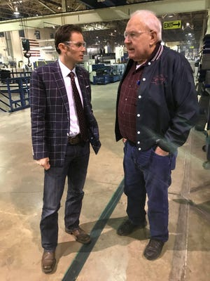 Sixth district Congressional candidate Jonathon Lamb speaks with local business owner Charlie Shaw during a visit to his casket factory.