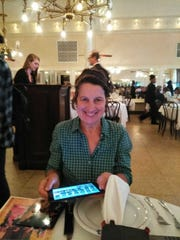 Cynthia Newport dines at a New Orleans restaurant on