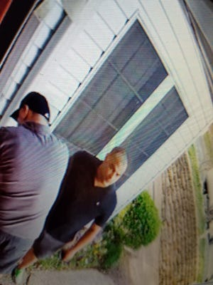 A still photo of drop box thieves caught on video..