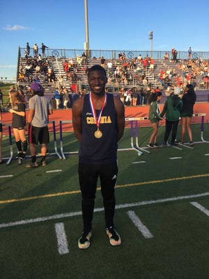 Colonia High School's Nelson Wyatt poses after winning the 100 meters at the GMC Championships on May 11.