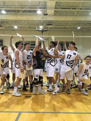 The Old Bridge volleyball team celebrates after winning the GMC title on May 19.