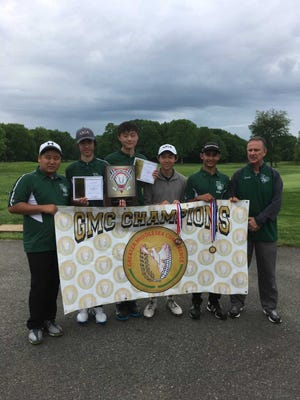 The East Brunswick High School golf team poses after winning the GMC championship on May 22.