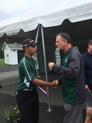 East Brunswick coach Bo Henning congratulates Arav Patel after he won the GMC individual golf championship on May 22.