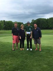 East Brunswick golfer Eegan McDermott is presented a scholarship honoring Jeff Byrnes. To his left is former East Brunswick athletic director Frank Noppenberger and Carolyn Byrnes.