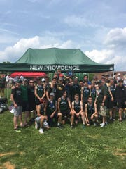 The New Providence boys track team pose after winning