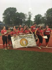 The Bishop Ahr softball team reacts to Katie Eicher (right) getting named the GMC Tournament's MVP.