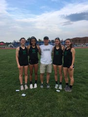 The Ridge 4x800 relay team poses after winning the Meet of Champions. (from left to right) Meghan Convery, Olivia Cicchetti, coach Tim Mooney, Morgan Lyons and Kaitlyn Van Baalen.