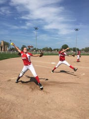 Madeline and Emma Trombly warm up before a game this season.