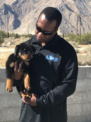 Marques Hill, the girls' basketball coach at Cathedral City High School, works as a dog trainer in his off time.