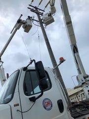 GPA crews work on power restoration.