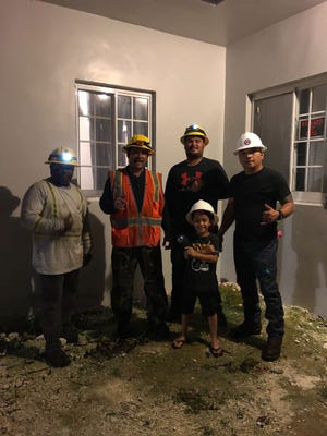 """7-year-old Rene """"Rumble"""" Purruganan poses with Guam Power Authority Crew, from left to right, Howard Kinlock, Roque Munoz, Zachary Crisostomo, and Edward Leon Guerrero"""