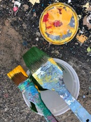 Two paintbrushes set aside for the Second Street mural.
