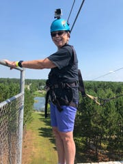 Marly Divvers prepares to ride the zipline at the NEW Zoo & Adventure Park in Suamico.