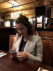 Sydney Baig, 14, keeps are eyes fixed on her phone.