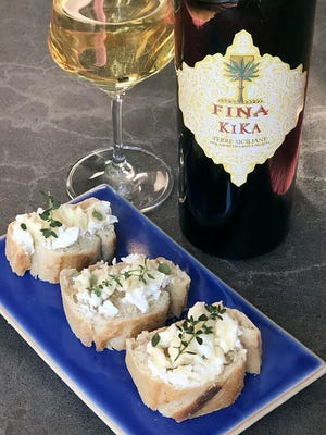 Fina Kika white blend from Sicily paired with goat cheese crostini.