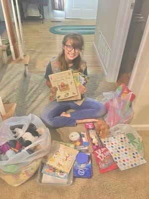 Bethany Taullie is pursuing her Girl Scout Gold Award by putting together birthday bags for families overwhelmed by financial burdens.