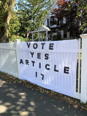 A banner supporting Article 17 outside a Needham home.