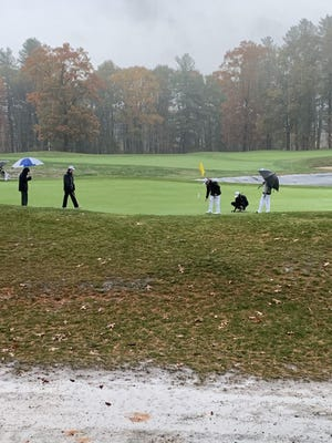 It was a wet finish to the end of the regular season for Wellesley High and Natick High golfers on Thursday at Sassamon Trace Golf Club in Natick.