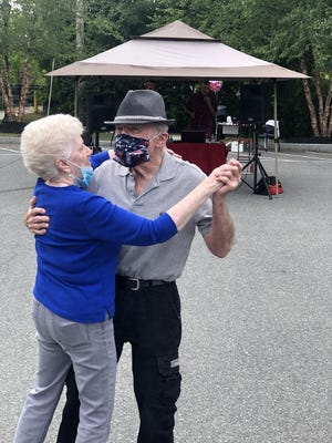 Dolores Tebo and Joe Hannish, who have been together more than 20 years, share coronavirus-safe dance. The Amesbury Council on Aging is hosting health and wellness events as well as games and other activities focused on fighting quarantine boredom with safety in mind.