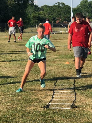 Durfee senior Emma Rezendes, a Herald News volleyball all-scholastic, runs the ladder drill during strength and conditioning workouts at the high school this past summer. Volleyball was one of four Durfee fall sports moved to the new Fall 2 season, starting in late February.