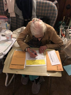 Gladys Beals, 101, votes from home using an absentee ballot.