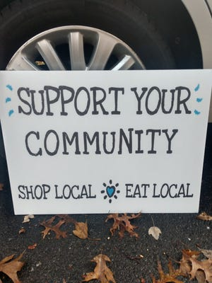 A sign campaign is underway in Acton to help support local businesses.