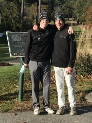 Nate O'Brien (left) and Will Coggeshall represented Marshfield High last Tuesday at the Patriot Cup Golf Tournament.