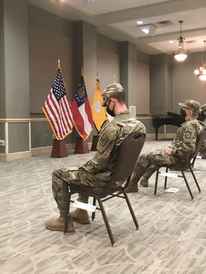 Augusta University Army ROTC cadets William Green, left, and Floyd Geesler wait on a Veterans Day Ceremony where they will take their Cadet Contracting Oath.
