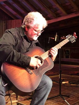 """John Bumgardner plays guitar and is an inspirational speaker. The Gaston County native tells his story in his new book """"Stroked by God."""""""