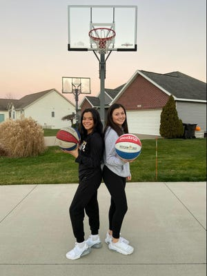 Zeeland West's Aaliyah Ybarra (left) and Marissa Ybarra ready to compete in their driveway.