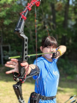 Anastasia Schutte won a gold medal in archery from the State Games of Michigan.