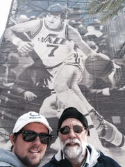 Bill Allen and son Gabe of Moorestown are on a pilgrimage to see an NBA game at each of the league's 29 arenas, including the Wells Fargo Center in Philadelphia, the home of the 76ers. Here they are in Salt Lake City, home of the Utah Jazz.