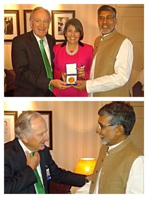 Iowa U.S. Sen. Tom Harkin greets human rights activist Kailash Satyarthi in Oslo, Norway, Wednesday.
