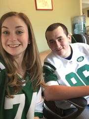 This March 2015 photo provided by Sarah Kardonsky shows her and Michael Pagano, who will be attending prom together at Division Avenue High School in Levittown, N.Y. in June 2015. Mike, who is autistic, is a big New York Jets fan, and Sarah got nine members of the New York Jets to make videos urging Mike to go to prom with her. Sarah's decision to invite a classmate with special needs is an example of a cultural change in how teens view prom, with some students using the big night as an opportunity to be inclusive rather than exclusive and to reach out to others.