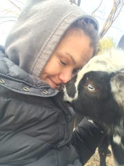 Farm owner Emily Hennelly enjoys a nuzzle from one of her goats at Anythyme Farm in Mendham.
