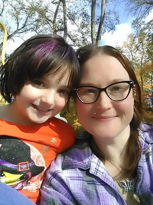 """This is Tammy Conley-Wilson of Penfield with her daughter Ginny Mae, 8. Tammy lost nearly 200 pounds and is a finalist in Sara Lee Bread's """"Delightful People"""" healthy transformations contest on Facebook."""