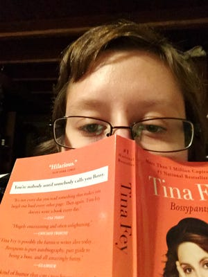 "A selfie of reporter Megan Williams reading ""Bossypants"" by Tina Fey."