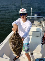 William Sundberg with a 4-pound flounder he caught off Dog Island. He used a live mud minnow.