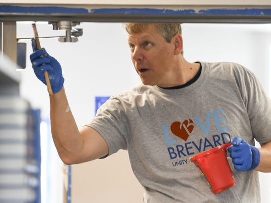 Erik Axsom of Love Brevard helps at  University Park Elementary in Melbourne. The group will be spending the next few weeks improving the school.