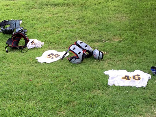 Hendersonville High players left uniforms and pads outside to air out following the Commandos' second practice session on Monday afternoon.