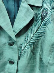 Peacock feather adorns this Maggy London pantsuit ($6.99)