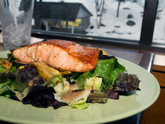 A Salmon salad with bacon glaze at Roundtop Mountian Resort's Fireside Pub & Grill Sunday.