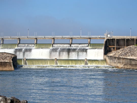 Water pours through the three open gates at Wesley Seale Dam when Lake Corpus Christi is full.