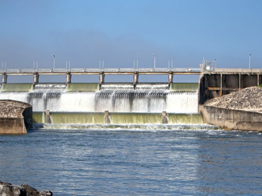 This shows water pouring from the three open gates at Wesley Seale Dam on Friday.